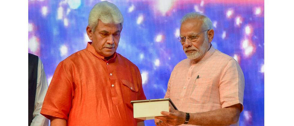 Prime Minister Narendra Modi with Telecom Minister Manoj Sinha launch the India Post Payments Bank (IPPB), in New Delhi on Saturday.