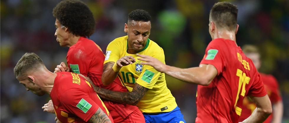 Brazil's forward Neymar vies for the ball with Belgium's midfielder Axel Witsel (2nd-L) and Belgium's defender Toby Alderweireld (L) during the Russia 2018 World Cup quarter-final. Manan Vatsyayana/AFP