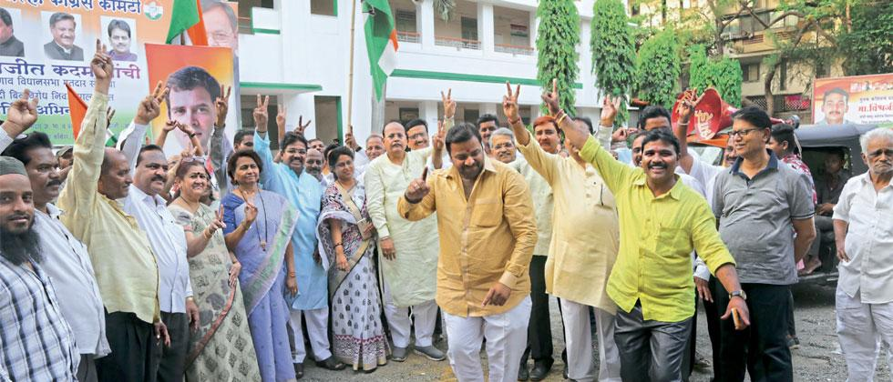 Congress workers in the city celebrate with victory signs and dance at Congress Bhavan on Saturday after the BJP's failure to  prove majority during the floor test in the Karnataka assembly