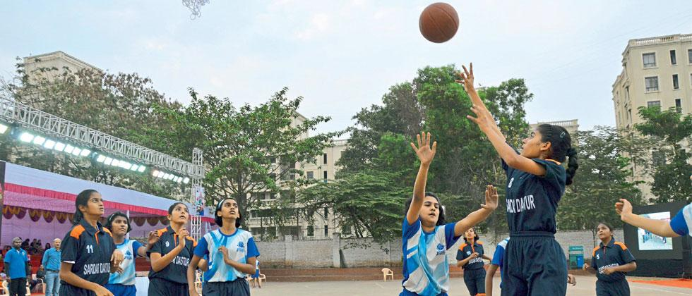 Sardar Dastur Girls School (in dark blue) in action against Abhinava English  Medium School in the Girl's Under-13 category of the Mayor's Cup basketball tournament
