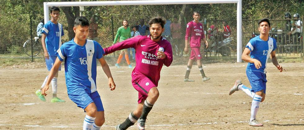 A player from KP XI (in blue) controls the ball during their match against City Club