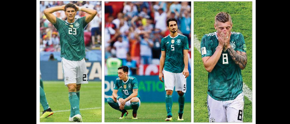 A combination of pictures show dejected German players (from left) Mario Gomez, Mesut Oezil, Mats Hummels and Toni Kroos after their loss against South Korea in Kazan on Wednesday