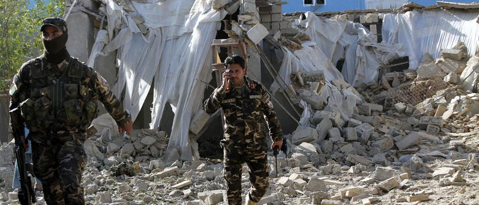 Kabul: Security forces inspect an explosion site in Lashkar Gah, capital of southern Helmand province, Afghanistan, Saturday, Feb. 24, 2018. Photo: AP/PTI