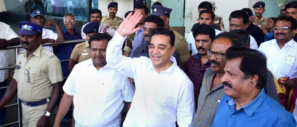 Actor Kamal Haasan waves at his supporters on his arrival at the airport in Madurai on Tuesday, a day before he is set to launch his political party. Photo - PTI