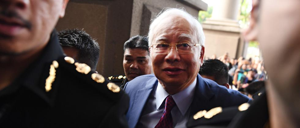 Malaysian ex-PM Najib charged with breach of trust, graft