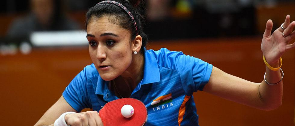` India's Manika Batra hits a return during the mixed doubles semi-final table tennis match. YE AUNG THU/AFP