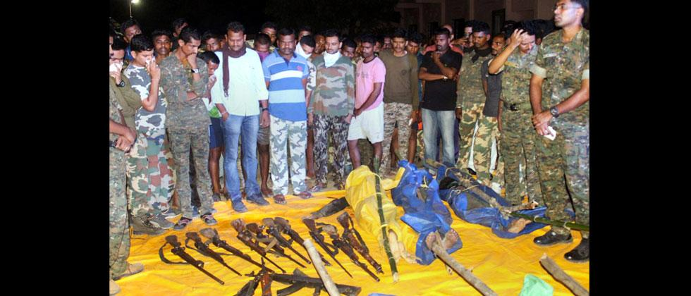 Security personnel show the guns recoverd from the Naxals killed in an encounter at Broriya forest area in Bhamragad taluka of Gadchiroli dustrict of Maharashtra on Sunday night. PTI Photo