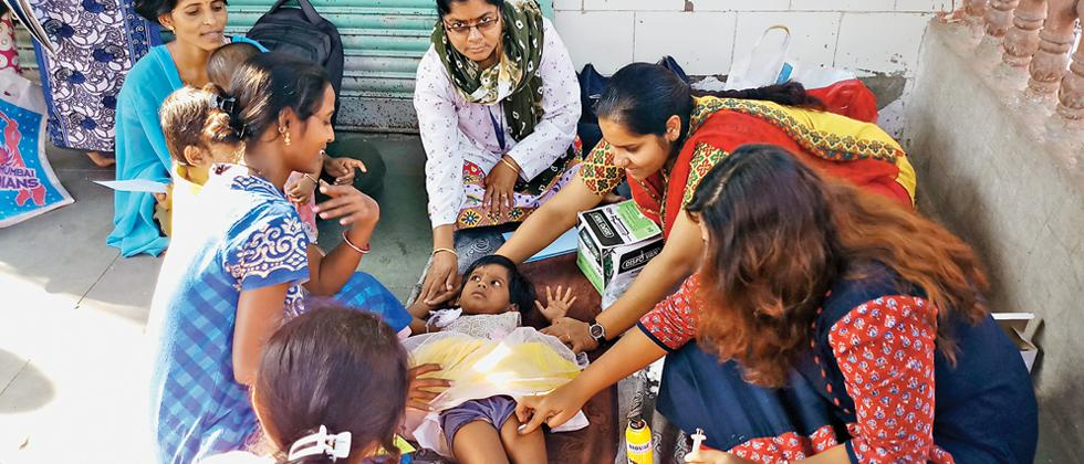 CLWs fight malnourishment among slum kids