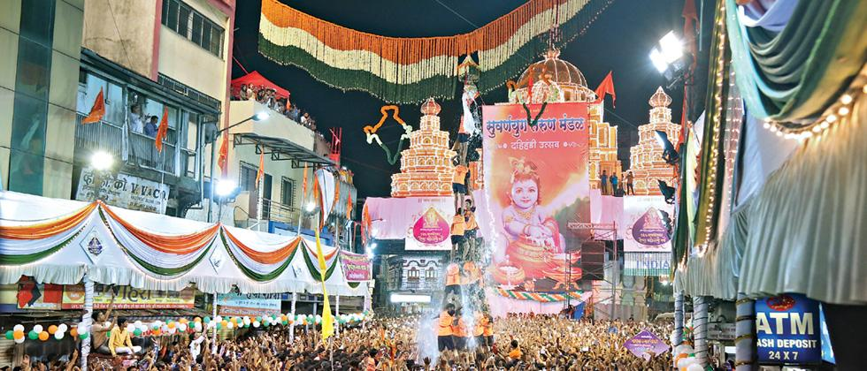 Suvarnayug Tarun Mandal celebrated Dahi Handi festival by breaking the pitcher by forming a human pyramid near Dagdusheth Halwai Temple on Tuesday. (Pic: Shahaji Jadhav)