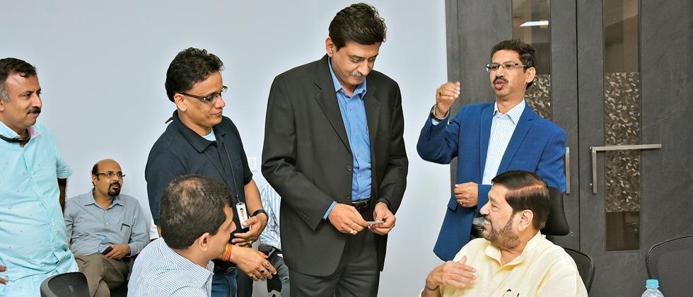 Guardian Minister Girish Bapat (R)interacting with centre heads of IT companies at  Hinjawadi IT hub.
