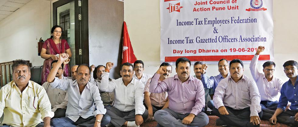 I-T Dept staffers protest for pending demands