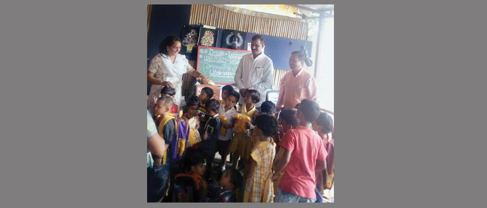 NGO distributes uniforms to underprivileged children