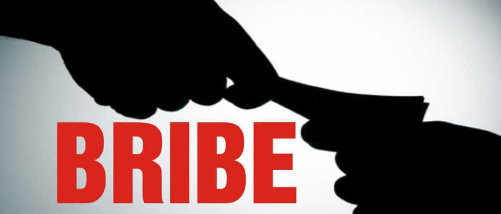 PSI, constable caught taking bribe