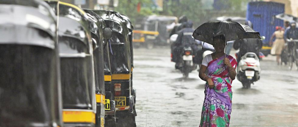 A woman walks with an umbrella in the rain on Monday. (pic: Vaibhav Thombare)