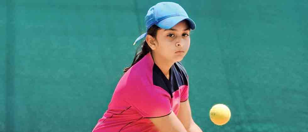 focussed: Rishita Patil in action against Preksha Pranjal at Maharashtriya Mandal tennis courts on Saturday.