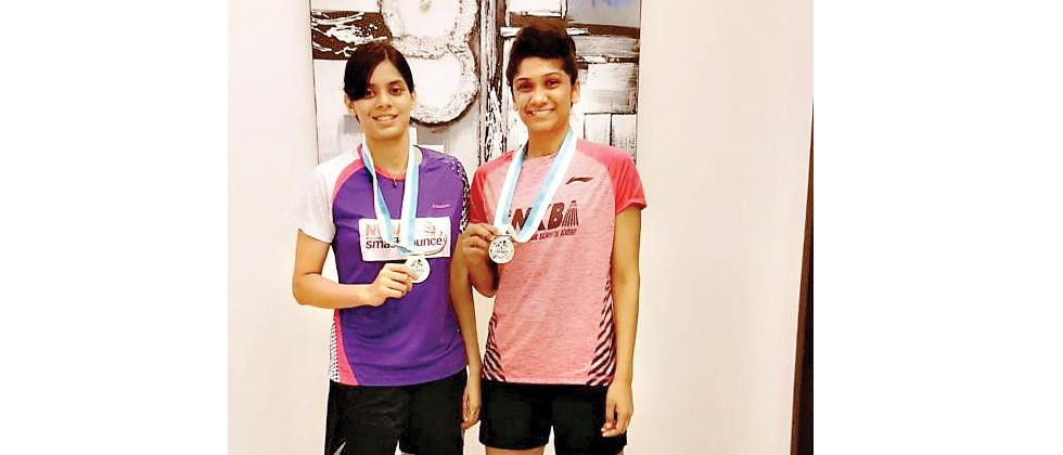 Sanyogita Ghorpade (right) and her partner Prajakta Sawant pose with their medals.