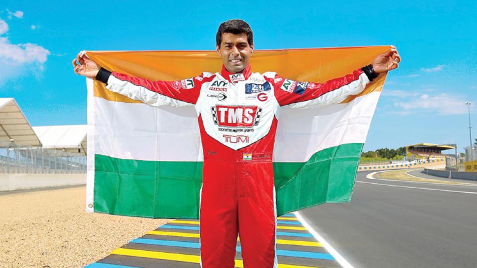 Karun Chandhok displays Indian tri-colour after completing Le Mans 24 Hours in Le Mans on Sunday.