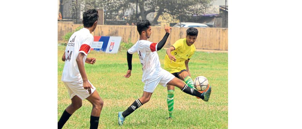 A player from Nowrosjee Wadia College (white) vies for the ball during their match against Arihant College of Arts on Monday.