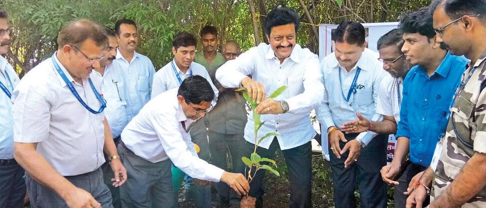 MP Anil Shirole, Director Pune Airport, Ajay Kumar, Dy Commandant, CISF, SK Bajpayee, are seen planting trees at Pune Airport premises.