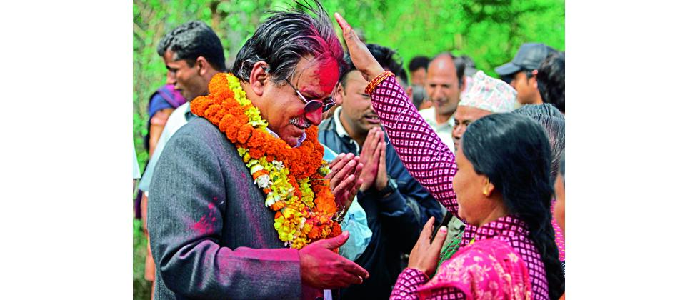 A file photo of Pushpa Kamal Dahal (Prachanda) being greeted by a woman with a vermillion mark on his forehead in Nepal.