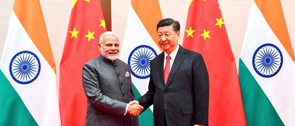 Modi and Xi discuss ways to further strengthen ties in Qingdao