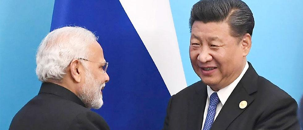 Handout photograph released by India's Press Information Bureau shows PM Narendra Modi shaking hands with the Chinese President Xi Jinping at the signing ceremony during the annual Shanghai Cooperation Organisation summit. AFP Photo/PIB