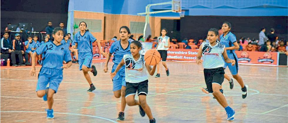 Players of Pune (in blue) in action against Mumbai Central at the Balewadi Sports Complex on Tuesday