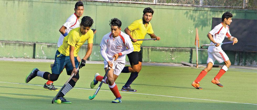 Bhopal team (in whites) plays their quarterfinal match against Railway Police in the 114th Aga Khan Cup Hockey tournament at the Major Dhyan Chand Poligras Stadium in Pimpri