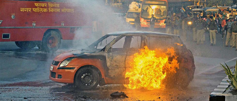 Karni Sena activists torched a car during a protest against Padmaavat in Bhopal