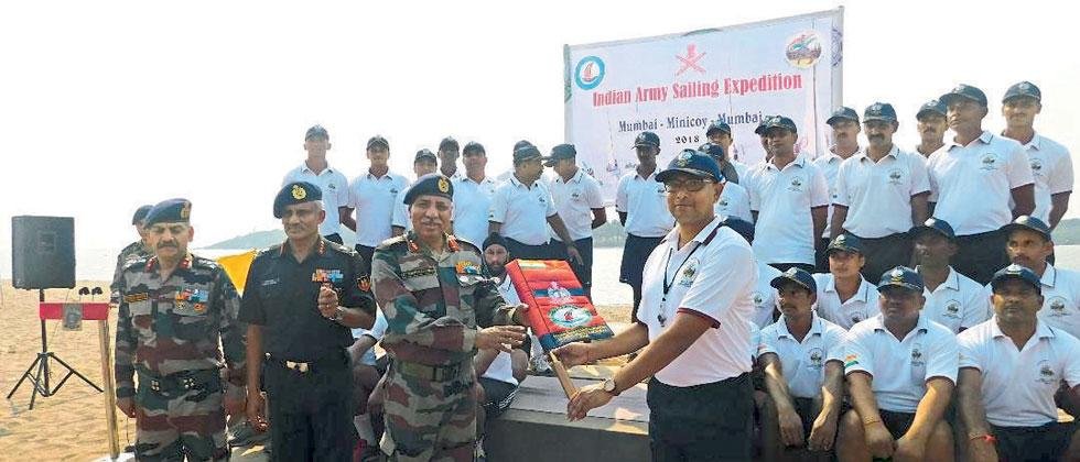 Lt Gen Vishwambhar Singh, General Officer Commanding, Mumbai Goa & Gujarat Area, handing over the expedition flag to the team in Marve