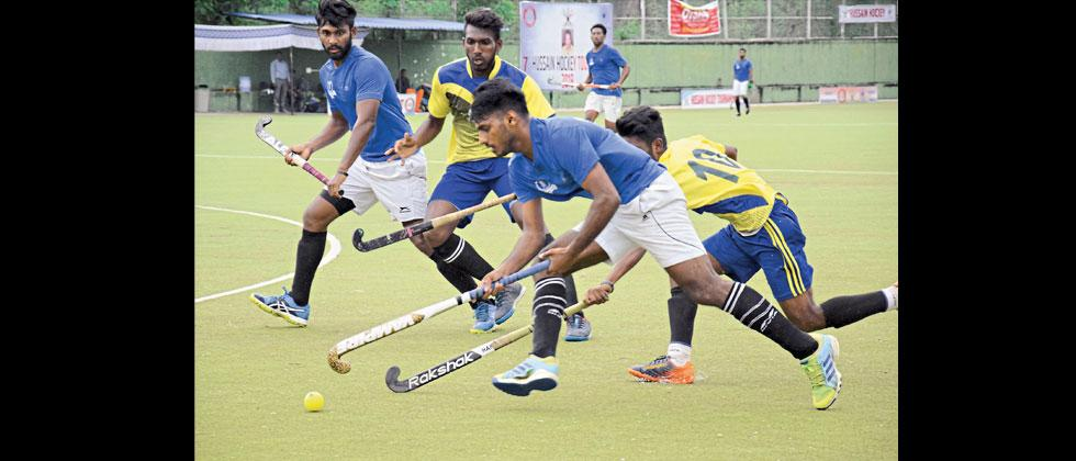 Players of Income Tax Department, Pune (in blue) in action against Priyadarshini  Sports Club, Khadki at Major Dyan Chand Hockey Stadium, Pimpri, on Wednesday