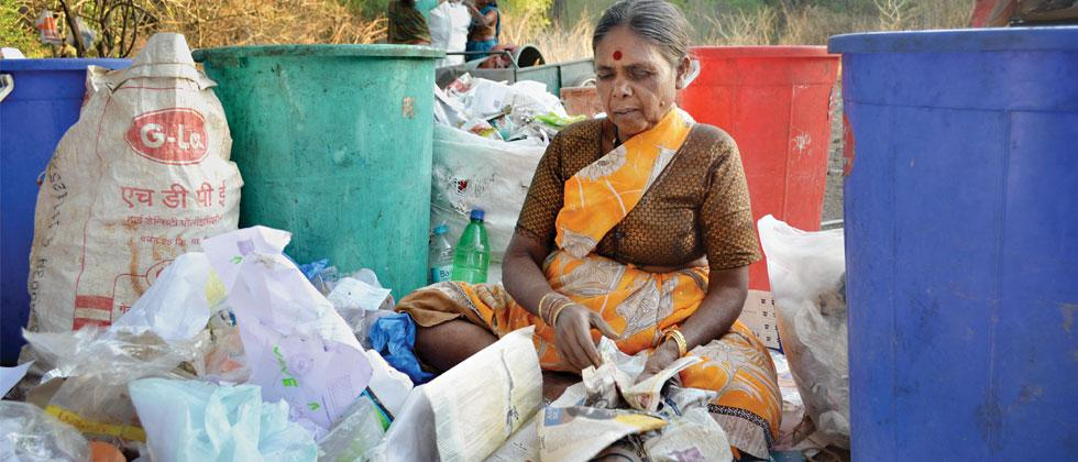 Due to lack of facility, a waste picker segregating waste near a garbage dump in the city. (File pic)