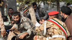 The picture shows soldiers and a Shiite Muslim cleric (R) sitting close to the ground seeking cover at the scene of an attack on a military parade that was marking the anniversary of the outbreak of its devastating 1980-1988 war with Saddam Hussein's Iraq
