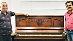 The piano of renowned music composer Shankar, is now a part of National Film Archive of India after the composer's grandson Santosh Kumar (L) donated the musical instrument.