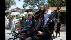 Afghan Taliban militants ride a motorbike as they took to the street to celebrate ceasefire on the second day of Eid in the outskirts of Jalalabad on June 16, 2018. Noorullah Shirzada/AFP