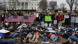 "Washington: Demonstrators participate in a ""lie-in"" during a protest in favor of gun control reform in front of the White House, Monday, Feb. 19, 2018. Photo - AP/PTI"
