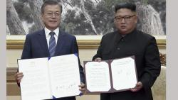 In this image made from video provided by Korea Broadcasting System (KBS), South Korean President Moon Jae-in, left, and North Korean leader Kim Jong Un pose after signing documents in Pyongyang, North Korea on Wednesday.