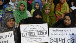 """This file photo taken on November 4, 2016 shows Indian Muslim women at a rally to oppose the Uniform Civil Code (UCC) that would outlaw the practice of """"triple talaq"""" in Ahmedabad."""