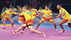 Puneri Paltan raider Rajesh Mondal tackled by Fazel Atrachali of Gujarat Fortunegiants in the PKL Season 5 match at Babu Banarasi Das Indoor Stadium in Lucknow on Tuesday.