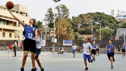 Players of Deccan Gymkhana A (in blue) in action against Cross Over during the  semi-final match at the Deccan Gymkhana basketball court on Wednesday.