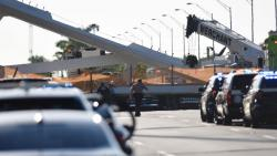 Authorities survey the scene of a pedestrian bridge collapse in Miami, Florida on March 15, 2018, crushing a number of cars below and reportedly leaving several people dead. Photo/Gaston De Cardenas/AFP