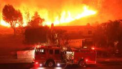 Nine die in California wildfires, tens of thousands forced to flee