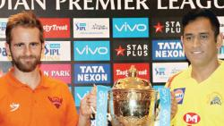 Kane Williamson, captain of Sunrisers Hyderabad (left) and MS Dhoni, captain of Chennai Super Kings, pose with the IPL 2018 Trophy