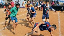 Players of Modern High School, NCL Campus (in blue) in action against JJ English Medium School at Nehru Stadium