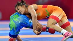 Vinesh Phogat (in orange) grapples with Uzbekistan's D Yakhshimuratova in the semifinals of womens 50kg freestyle wrestling event, at Asian Games 2018, in Jakarta on Monday.