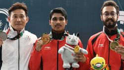 From L to R: Silver medallist Japan's Tomoyuki Matsuda, gold medallist India's Saurabh Chaudhary and bronze medallist India's Abhishek Verma pose with their medals during their victory ceremony for the 10m air pistol men shooting final.