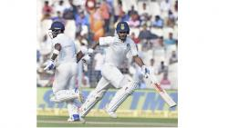 India's Shikhar Dhawan and KL Rahul cross for a run during Day 4 of the first cricket test math against Sri Lanka at Eden Gardens in Kolkata on Sunday. PTI Photo