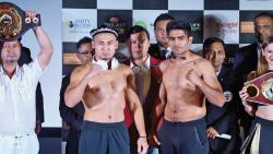Indian boxer Vijender Singh (right) and Chinese boxer Zulpilkar Maimaitiali during their face-off in Mumbai.
