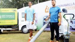 Indian tennis player Ramkumar Ramanathan (left) with Spanish tennis player Ricardo Ojedo Lara at the Adar Poonawalla Clean City Initiative stall