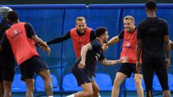 England's forward Harry Kane, defender Kyle Walker, midfielder Jordan Henderson and teammates take part in a training session at Stadium Spartak Zelenogorsk, St. Petersburg